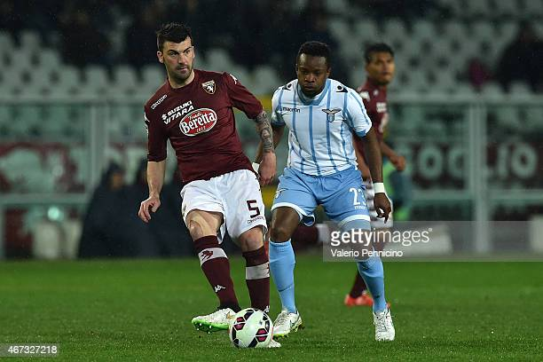 Cesare Bovo of Torino FC in action against Ogenyi Eddy Onazi of SS Lazio during the Serie A match between Torino FC and SS Lazio at Stadio Olimpico...