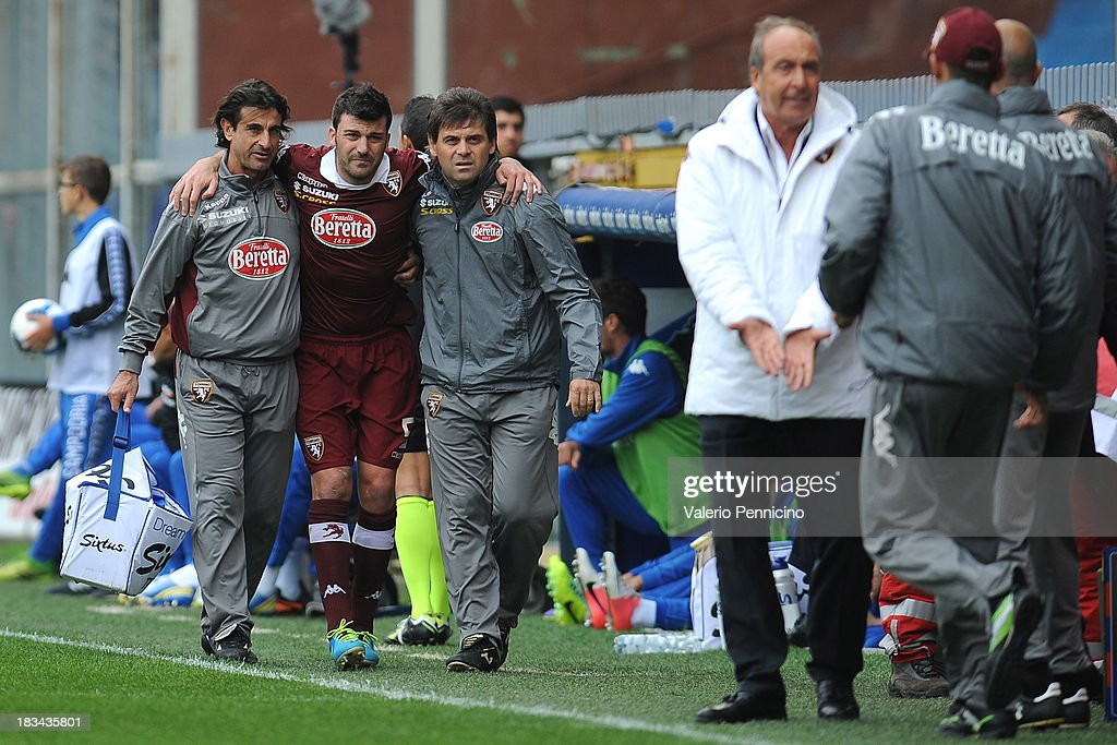 <a gi-track='captionPersonalityLinkClicked' href=/galleries/search?phrase=Cesare+Bovo&family=editorial&specificpeople=605373 ng-click='$event.stopPropagation()'>Cesare Bovo</a> of Torino FC is helped from the pitch after sustaining an injury during the Serie A match between UC Sampdoria and Torino FC at Stadio Luigi Ferraris on October 6, 2013 in Genoa, Italy.