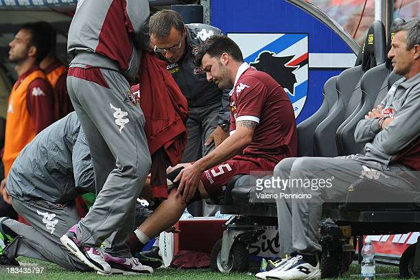 Cesare Bovo of Torino FC receives treatment during the Serie A match between UC Sampdoria and Torino FC at Stadio Luigi Ferraris on October 6 2013 in...