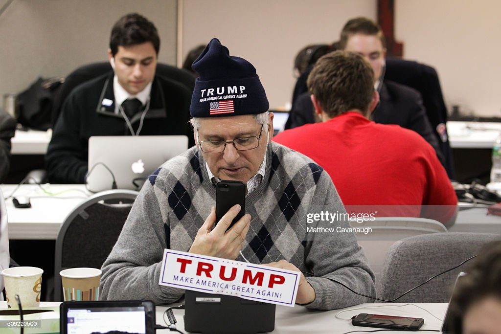 Cesare Del Vaglio, a campaign volunteer for Republican presidential candidate Donald Trump, makes phone calls to New Hampshire voters at Trump's campaign office on February 9, 2016 in Manchester, New Hampshire. Voters throughout the state are heading to the polls as the New Hampshire Primary, also known as the first-in-the-nation primary, continues the process of selecting the next president of the United States.