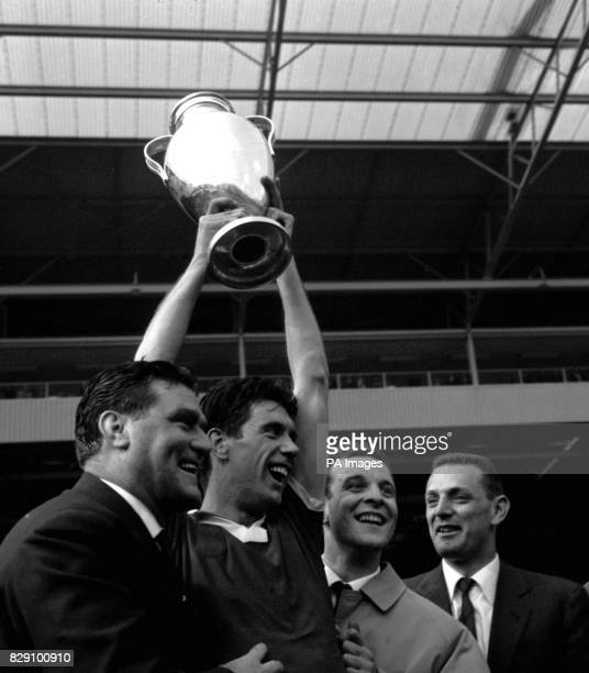 Cesare Maldini captain of Milan holds aloft the European Cup after his team beat the Portuguese holders Benfica 21 in the Final at Wembley The...