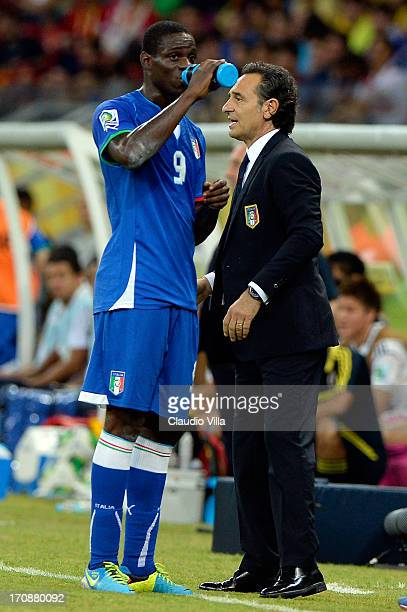 Cesare Prandelli head coach of Italy speaks to Mario Balotelli during the FIFA Confederations Cup Brazil 2013 Group A match between Italy and Japan...
