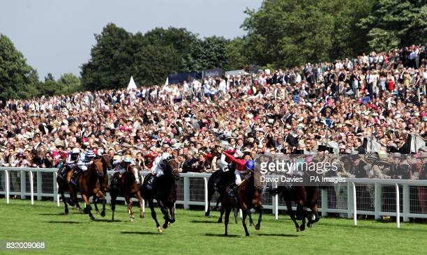 Cesare ridden by jockey Jamie Spencer wins against Stronghold ridden by jockey Richard Hughes in the Royal Hunt Cup at Ascot racecourse
