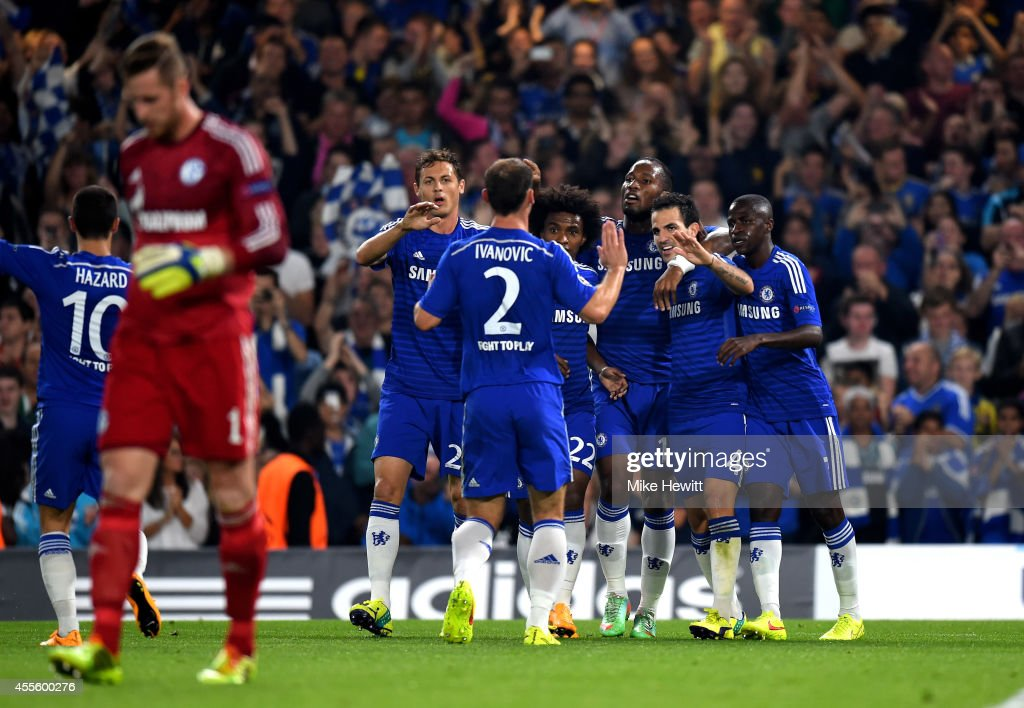 Cesc Fabregas (2nd R) #4 of Chelsea celebrates with teammates after scoring the opening goal during the UEFA Champions League Group G match between Chelsea and FC Schalke 04 on September 17, 2014 in London, United Kingdom.