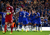 Cesc Fabregas of Chelsea celebrates with teammates after scoring the opening goal during the UEFA Champions League Group G match between Chelsea and...