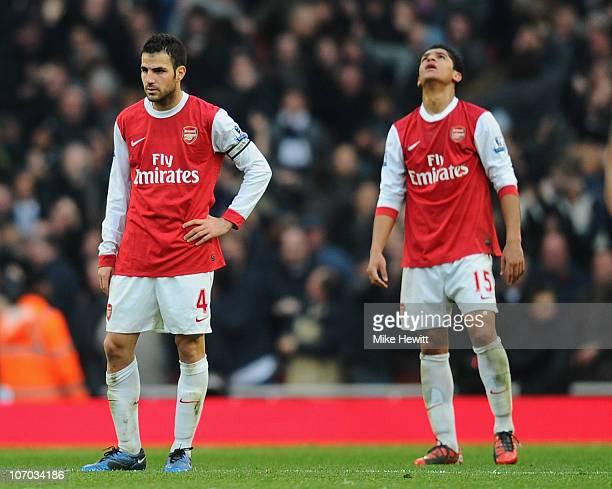 Cesc Fabregas and Denilson of Arsenal react to Tottenham's winning goal during the Barclays Premier League match between Arsenal and Tottenham...