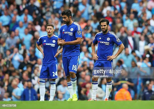Cesc Fabregas and Diego Costa of Chelsea look dejected after the third Manchester City goal scored by Fernandinho of Manchester City during the...
