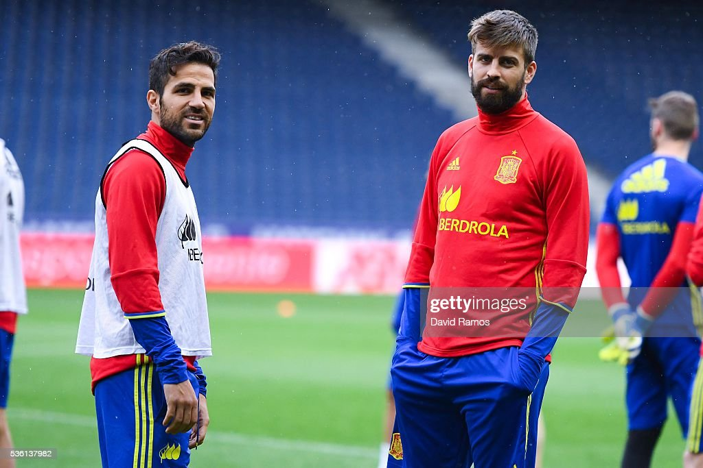 Cesc Fabregas (L) and <a gi-track='captionPersonalityLinkClicked' href=/galleries/search?phrase=Gerard+Pique&family=editorial&specificpeople=227191 ng-click='$event.stopPropagation()'>Gerard Pique</a> of Spain look on during a training session at the Red Bull Arena stadium on May 31, 2016 in Salzburg, Austria.