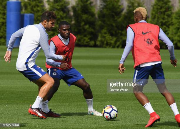 Cesc Fabregas and Jeremie Boga of Chelsea during a training session at Chelsea Training Ground on August 10 2017 in Cobham England