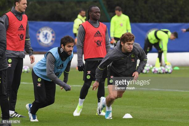 Cesc Fabregas and Marcos Alonso of Chelsea during a training session at Chelsea Training Ground on April 28 2017 in Cobham England