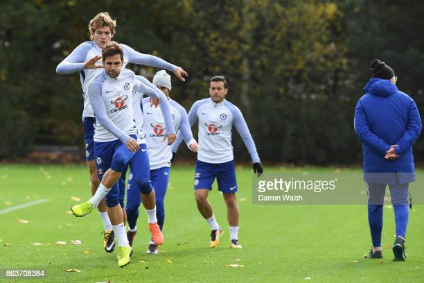 Cesc Fabregas and Marcos Alonso of Chelsea during a training session at Chelsea Training Ground on October 20 2017 in Cobham United Kingdom