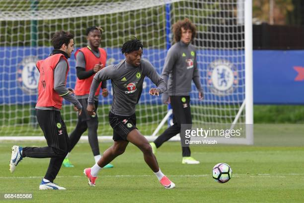 Cesc Fabregas and Nathaniel Chalobah of Chelsea during a training session at Chelsea Training Ground on April 14 2017 in Cobham England