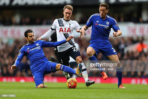 Cesc Fabregas and Nemanja Matic of Chelsea tackle Christian Eriksen of Tottenham Hotspur during the Barclays Premier League match between Tottenham...