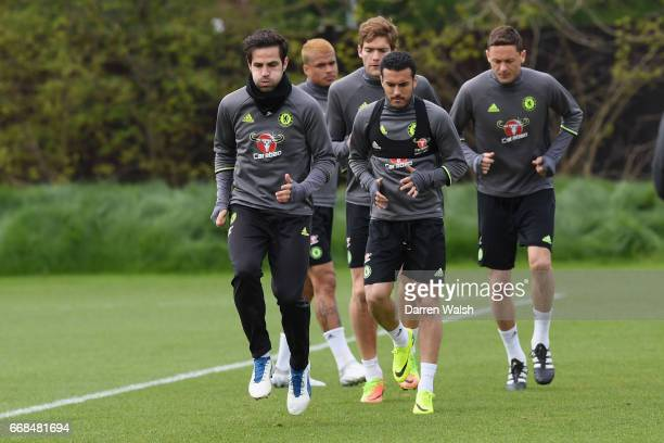 Cesc Fabregas and Pedro of Chelsea during a training session at Chelsea Training Ground on April 14 2017 in Cobham England