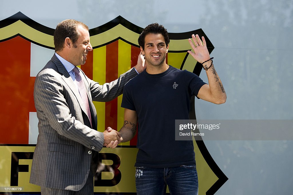 Cesc Fabregas (R) and the FC Barcelona president <a gi-track='captionPersonalityLinkClicked' href=/galleries/search?phrase=Sandro+Rosell&family=editorial&specificpeople=2363208 ng-click='$event.stopPropagation()'>Sandro Rosell</a> pose during his presentation as the new signing for FC Barcelona at Camp Nou sports complex on August 15, 2011 in Barcelona, Spain.