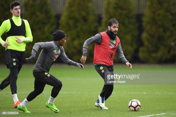 Cesc Fabregas and Willian of Chelsea during a training session at Chelsea Training Ground on March 10 2017 in Cobham England