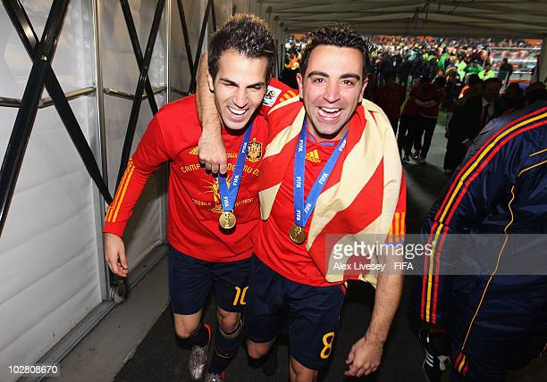 Cesc Fabregas and Xavi Hernandez celebrate in the tunnel after the 2010 FIFA World Cup South Africa Final match between Netherlands and Spain at...