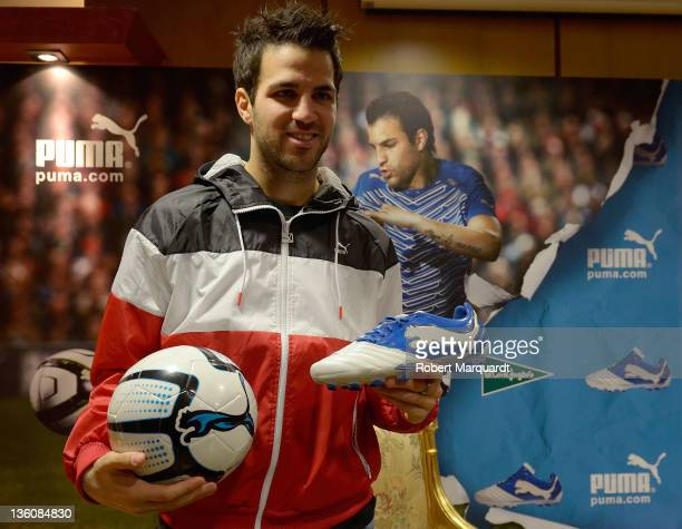 Cesc Fabregas attends a press presentation of the new Puma PowerCat 112 shoe at the Corte Ingles store on December 23 2011 in Barcelona Spain