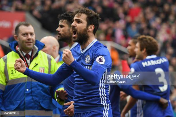 Cesc Fabregas celebrates as Gary Cahill of Chelsea scores their second goal during the Premier League match between Stoke City and Chelsea at Bet365...
