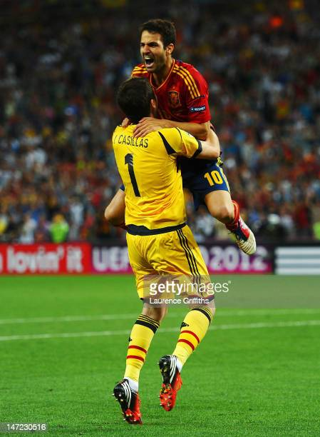 Cesc Fabregas celebrates scoring the winning penalty with Iker Casillas of Spain during the UEFA EURO 2012 semi final match between Portugal and...