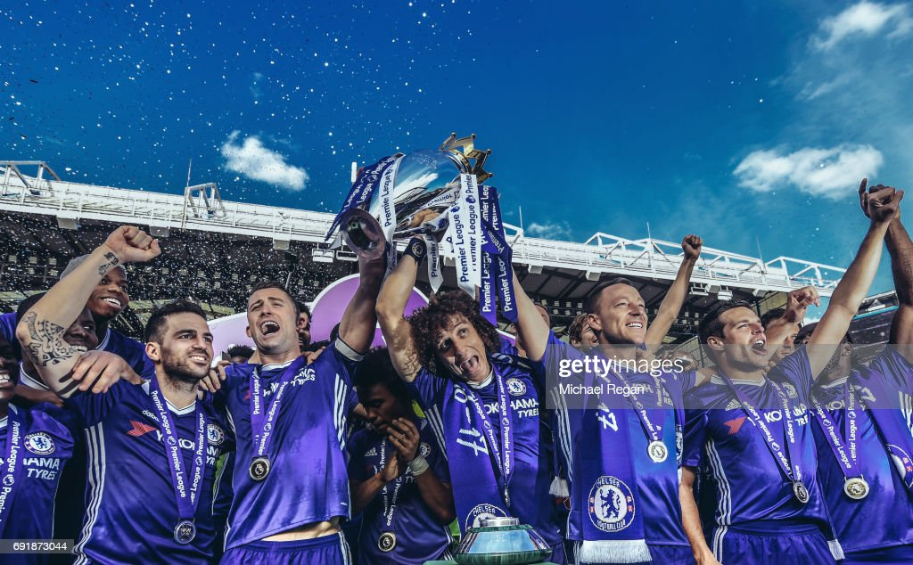 Cesc Fabregas, Gary Cahill, David Luiz, John Terry and Cesar Azpilicueta of Chelsea celebrate with the Premier League Trophy after the Premier League match between Chelsea and Sunderland at Stamford Bridge on May 21, 2017 in London, England.