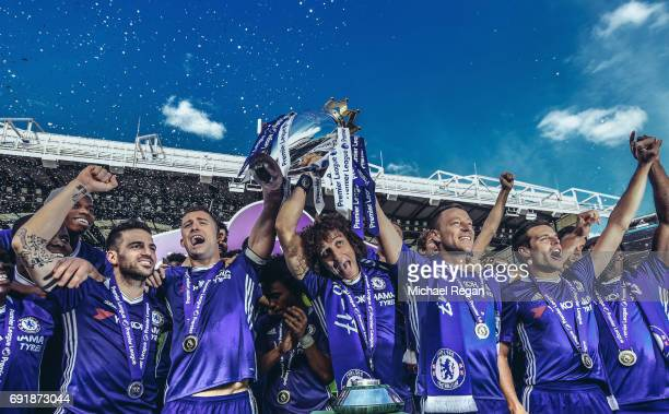 Cesc Fabregas Gary Cahill David Luiz John Terry and Cesar Azpilicueta of Chelsea celebrate with the Premier League Trophy after the Premier League...