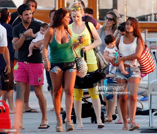 Cesc Fabregas his girlfriend Daniella Semaan their daughter Lia Fabregas Leo Messi's girlfriend Antonella Rocuzzo and her son Thiago Messi are seen...