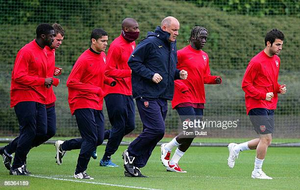 Cesc Fabregas leads the group during an Arsenal training session prior to Tuesday's Champions League fixture against Manchester United at London...