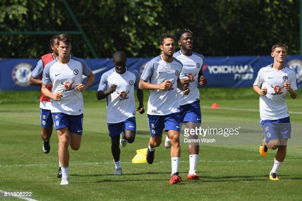 Cesc Fabregas Michy Batshuayi N'Golo Kante Kyle Scott and Loic Remy of Chelsea during a training session at Chelsea Training Ground on July 10 2017...