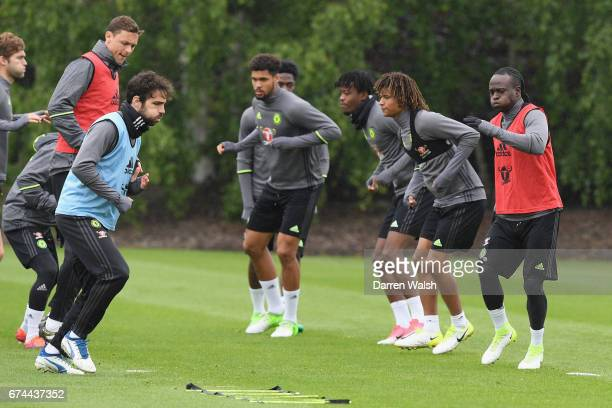 Cesc Fabregas Nemanja Matic and Victor Moses of Chelsea during a training session at Chelsea Training Ground on April 28 2017 in Cobham England