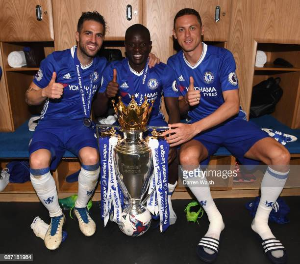 Cesc Fabregas N'Golo Kante and Nemanja Matic of Chelsea celebrate winning the league following the Premier League match between Chelsea and...