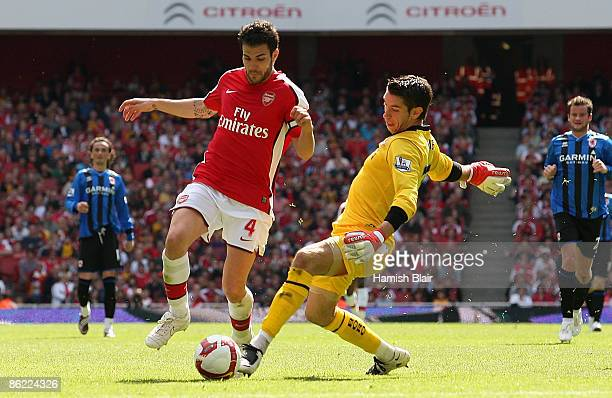 Cesc Fabregas of Arsenal dribbles past Middlesbrough goalkeeper Brad Jones to score the second goal during the Barclays Premier League match between...