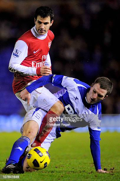 Cesc Fabregas of Arsenal is tackled by Craig Gardner of Birmingham during the Barclays Premier Leaue match between Birmingham City and Arsenal at St...