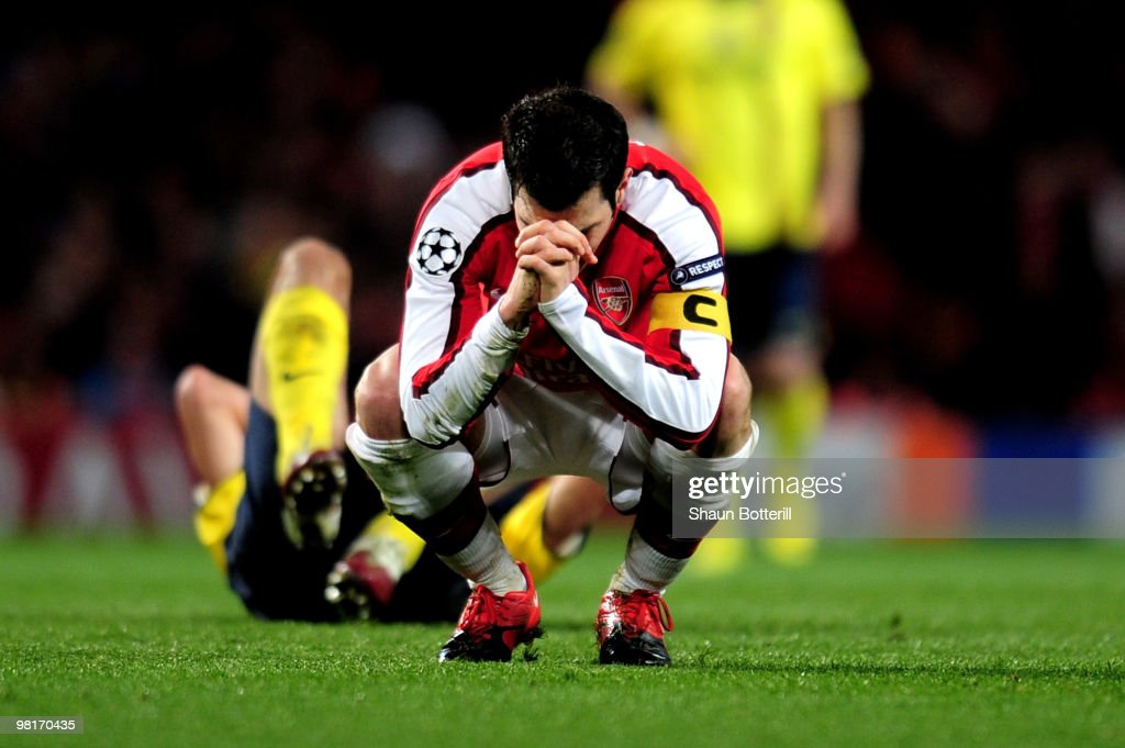 Cesc Fabregas of Arsenal reacts after being shown a yellow card by referee Massimo Busacca of Switerland during the UEFA Champions League quarter final first leg match between Arsenal and FC Barcelona at the Emirates Stadium on March 31, 2010 in London, England. Cesc Fabregas of Arsenal will now miss the next match at the Camp Nou in Barcelona.