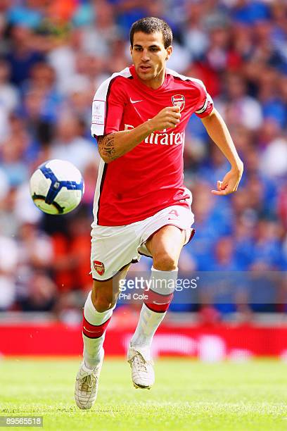 Cesc Fabregas of Arsenal runs with the ball during the Emirates Cup match between Arsenal and Glasgow Rangers at the Emirates Stadium on August 2...