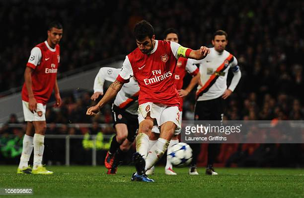 Cesc Fabregas of Arsenal scores their third goal from a penalty during the UEFA Champions League Group H match between Arsenal and FC Shakhtar...