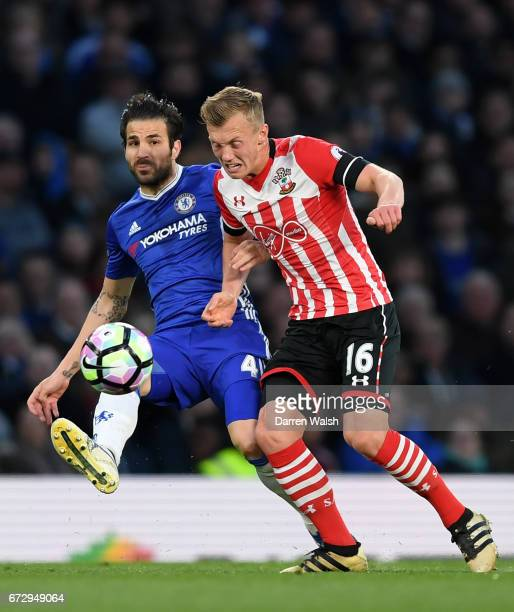 Cesc Fabregas of Chelsea and James WardProwse of Southampton battle for the ball during the Premier League match between Chelsea and Southampton at...