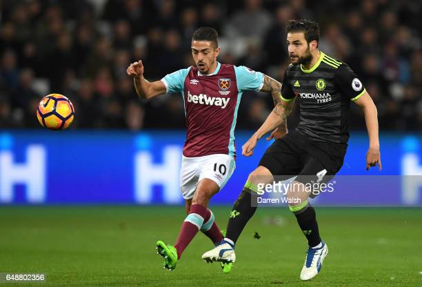 Cesc Fabregas of Chelsea and Manuel Lanzini of West Ham United in action during the Premier League match between West Ham United and Chelsea at...