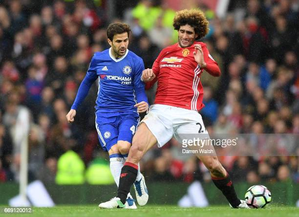 Cesc Fabregas of Chelsea and Marouane Fellaini of Manchester United battle for possession during the Premier League match between Manchester United...