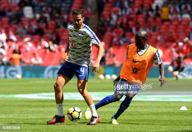 Cesc Fabregas of Chelsea and N'Golo Kante of Chelsea warm up prior to the The FA Community Shield final between Chelsea and Arsenal at Wembley...