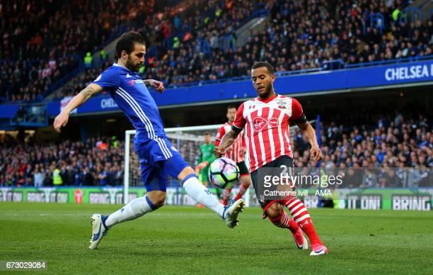 Cesc Fabregas of Chelsea and Ryan Bertrand of Southampton during the Premier League match between Chelsea and Southampton at Stamford Bridge on April...