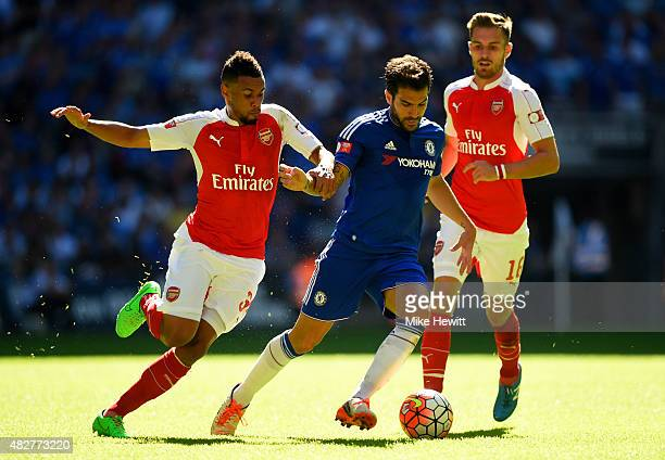 Cesc Fabregas of Chelsea battles for the ball with Francis Coquelin of Arsenal and Aaron Ramsey of Arsenal during the FA Community Shield match...