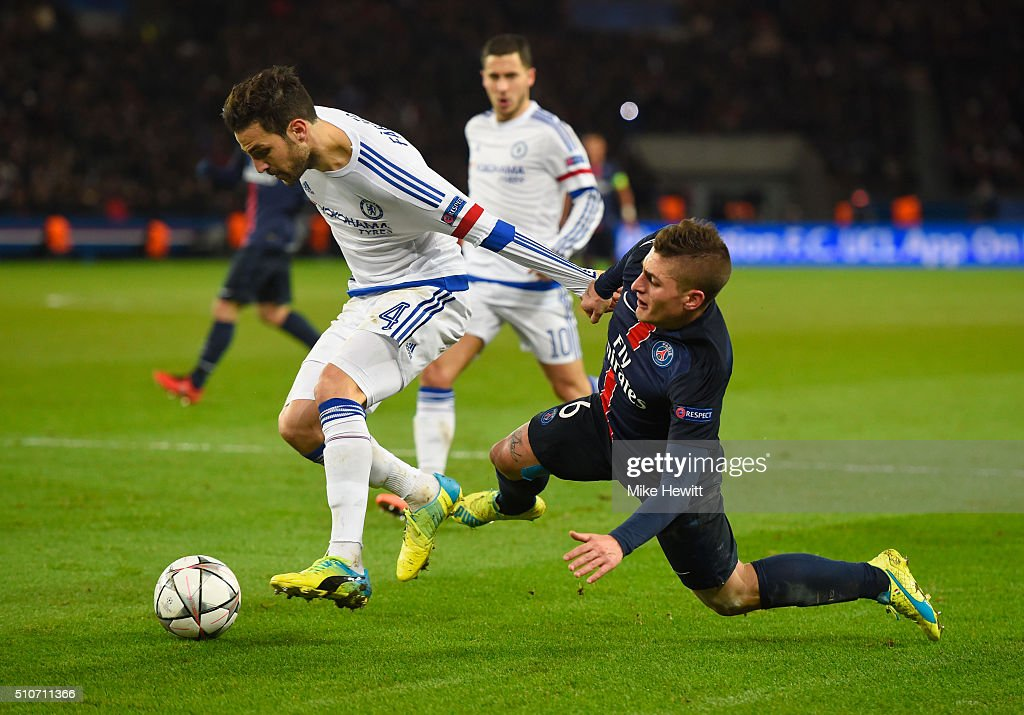Cesc Fabregas of Chelsea battles with <a gi-track='captionPersonalityLinkClicked' href=/galleries/search?phrase=Marco+Verratti&family=editorial&specificpeople=7256509 ng-click='$event.stopPropagation()'>Marco Verratti</a> of Paris Saint-Germain during the UEFA Champions League round of 16 first leg match between Paris Saint-Germain and Chelsea at Parc des Princes on February 16, 2016 in Paris, France.