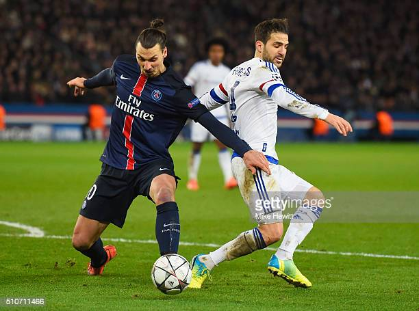 Cesc Fabregas of Chelsea battles with Zlatan Ibrahimovic of Paris SaintGermain during the UEFA Champions League round of 16 first leg match between...