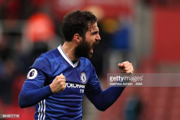 Cesc Fabregas of Chelsea celebrates at the end of the Premier League match between Stoke City and Chelsea at Bet365 Stadium on March 18 2017 in Stoke...