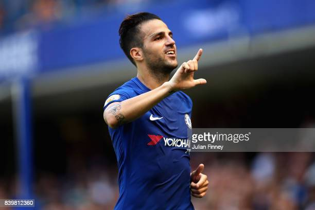 Cesc Fabregas of Chelsea celebrates scoring his sides first goal during the Premier League match between Chelsea and Everton at Stamford Bridge on...