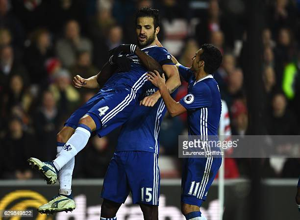 Cesc Fabregas of Chelsea celebrates scoring his sides first goal with his Chelsea team mates during the Premier League match between Sunderland and...