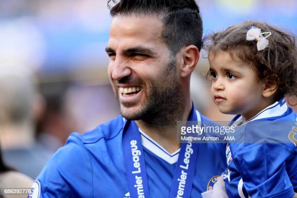 Cesc Fabregas of Chelsea celebrates with his daughter at the end of the Premier League match between Chelsea and Sunderland at Stamford Bridge on May...