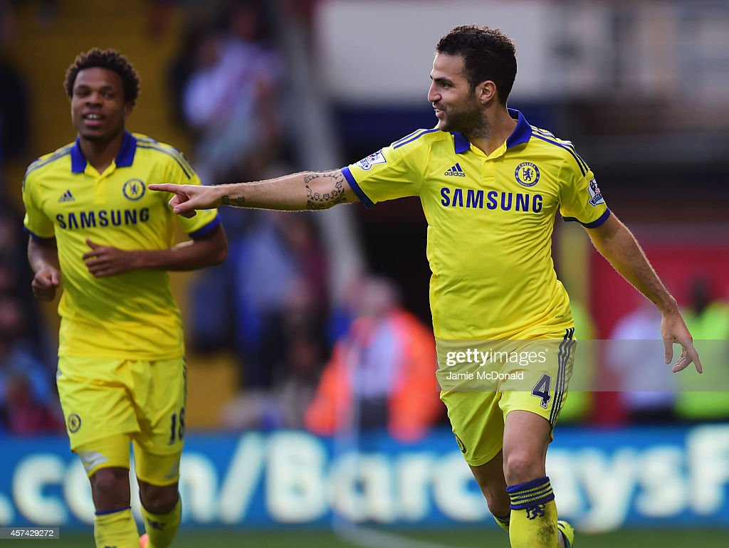 Cesc Fabregas of Chelsea celebrates with Loic Remy (L) as he scores their second goal during the Barclays Premier League match between Crystal Palace and Chelsea at Selhurst Park on October 18, 2014 in London, England.