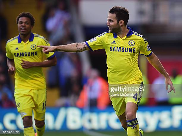 Cesc Fabregas of Chelsea celebrates with Loic Remy as he scores their second goal during the Barclays Premier League match between Crystal Palace and...